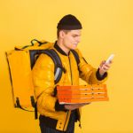 contacless-delivery-service-during-quarantine-man-delivers-food-shopping-bags-during-insulation-emotions-deliveryman-isolated-yellow_155003-7141